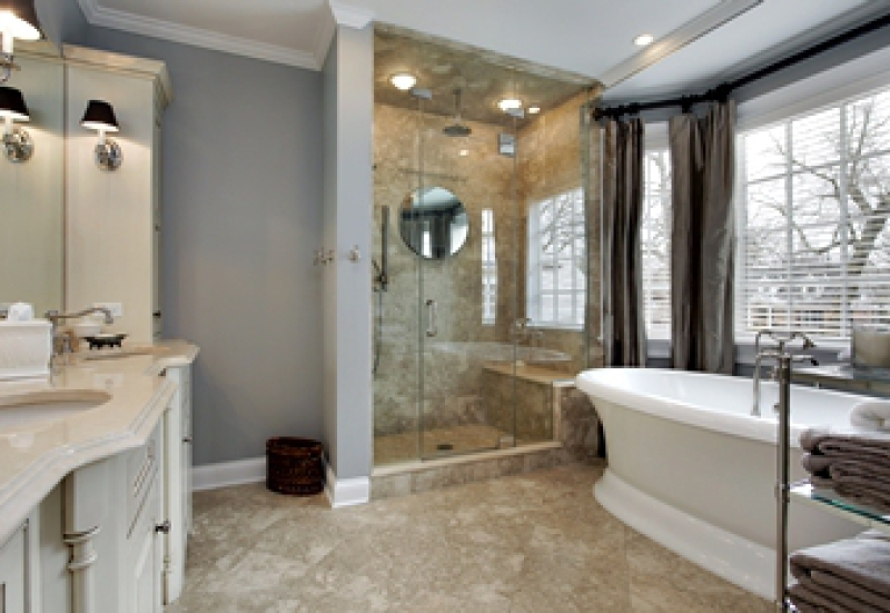 Bathroom with free-standing bathtub and custom walk-in shower with seat