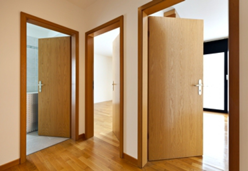 Smooth luan interior doors with stained trim