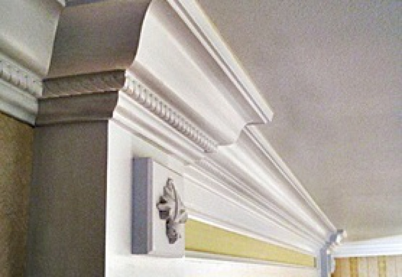 Crown molding in a formal residential hallway