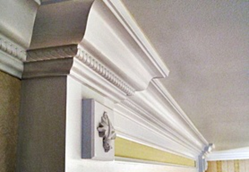 Ornate crown molding in a formal hallway